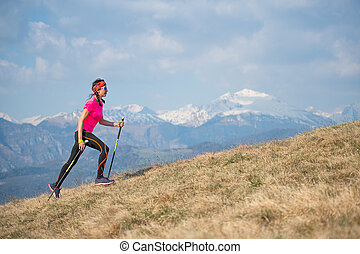 Young athlete running in the mountains and skyrunning during a workout