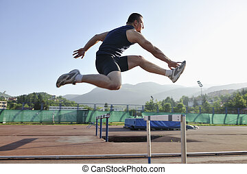 young athlete running - young healthy man run on athletic...
