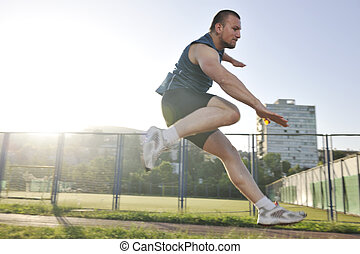 young athlete running - young healthy man run on athletic ...