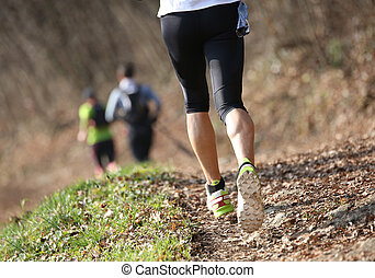 young athlete runs on the trail on mountains during a cross-coun