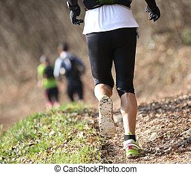 athlete runs on the trail on mountains