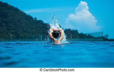 Young athlete swimming in the ocean