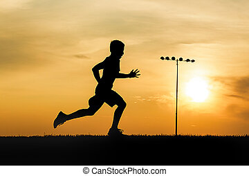 Young athlete trains at sunset.