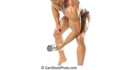 Young athlete trains biceps silver dumbbells.