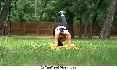 Young Athlete Woman in Sport Outfit Engaged Fitness Lying on...