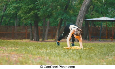 Young Athlete Woman in Sport Outfit Engaged Practicing Yoga...