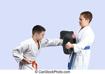 Young athletes are training blows