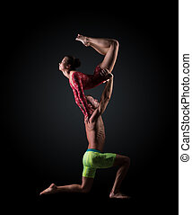 Young athletes perform acrobatic support