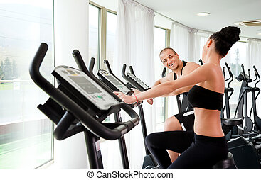 Young athletic couple gym