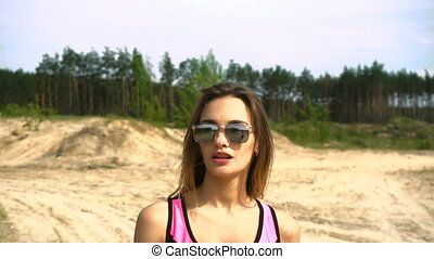 young athletic girl walks in nature