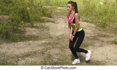 young athletic slim girl practiced outdoors