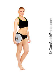Young athletic woman holding balance board