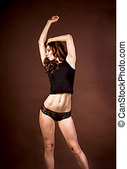Young athletic woman in black shirt. Studio shot