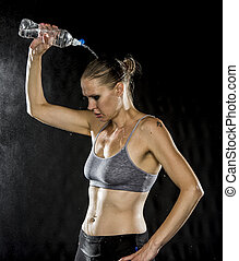Young Athletic Woman Pouring Water Over Head