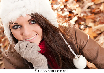 Young atractive girl in the autumn