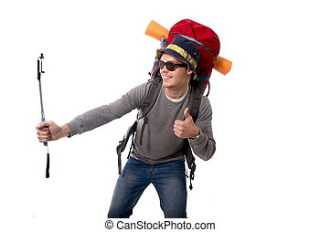 young atractive traveler backpacker taking selfie photo with stick carrying backpack ready for adventure