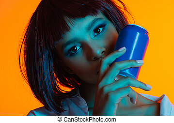 young attractive african american woman holding can and looking at camera