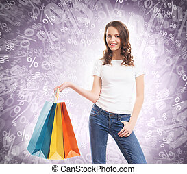 Young, attractive and happy shopping girl with the bright shoppi