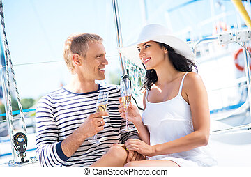 Young, attractive and rich couple have a party on a luxury...