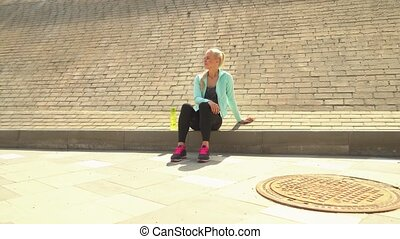 Young, attractive and sporty blond girl in sportswear...