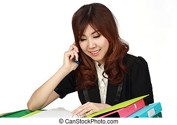 Young attractive Asian businesswoman sitting using mobile phone isolated on white background