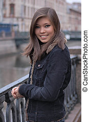 Young attractive asian woman in jacket