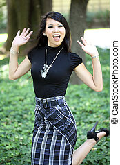 Young attractive asian woman in skirt and top