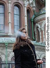 Young attractive asian woman smoking