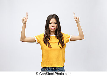 young attractive asian woman who points to the finger with unhappy emotion.