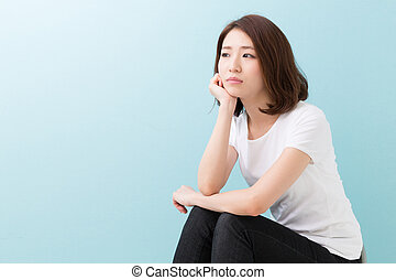 young attractive asian woman who thinks