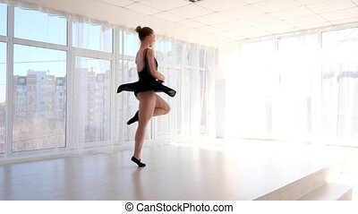 Young attractive ballerina practising ballet moves - Young...