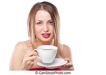 Young attractive blond woman drinking tea