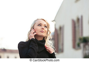 Young attractive blond woman listening intently