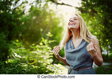 Young attractive blonde woman laughing