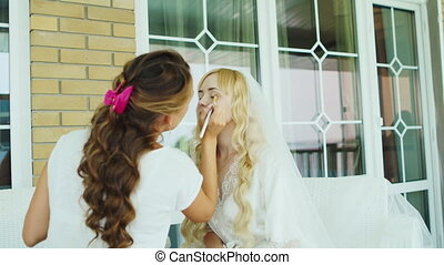 Young attractive bride impose foundation