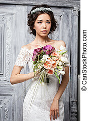 Young attractive bride with flowers