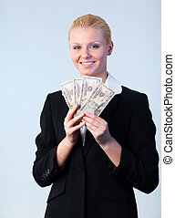 Business woman holding dollars to the camera