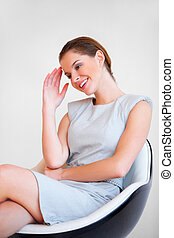 Young attractive business woman sitting on chair