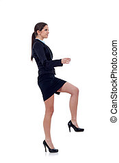 business woman stepping on imaginary step - Young attractive...