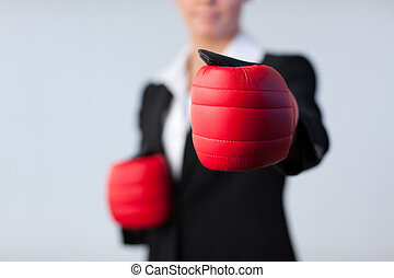 Business woman with boxing gloves on