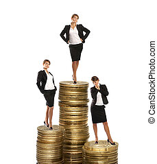 Young attractive businessladies on coin towers