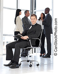 Young attractive businessman in office working