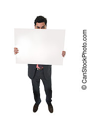 young attractive businessman in suit and tie holding white blank billboard or advertising panel