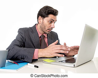 attractive businessman in suit and tie working in stress at offi
