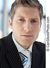Young Attractive businessman looking at camera
