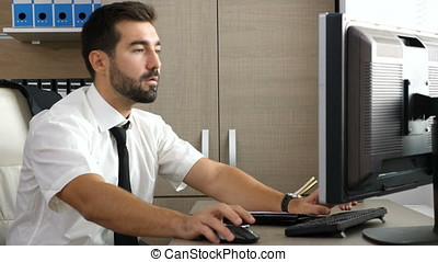 Young attractive businessman relaxing at his desk in the office