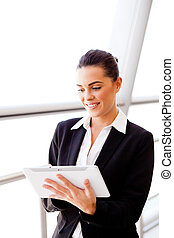 young attractive businesswoman using tablet computer