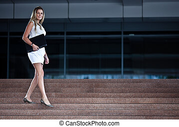 Young attractive businesswoman with a notebook
