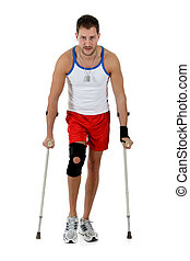 Young  attractive caucasian man athlete, crutches
