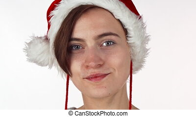 Young attractive Christmas girl looking shocked or surprised